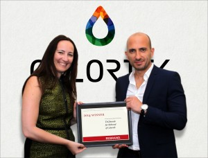 Maya-Karanouh-CEO-of-Tagbrands-handing-Yahya-Kassaa-CEO-of-Colortek-the-Rebrand-Award.-1-300x228.jpg