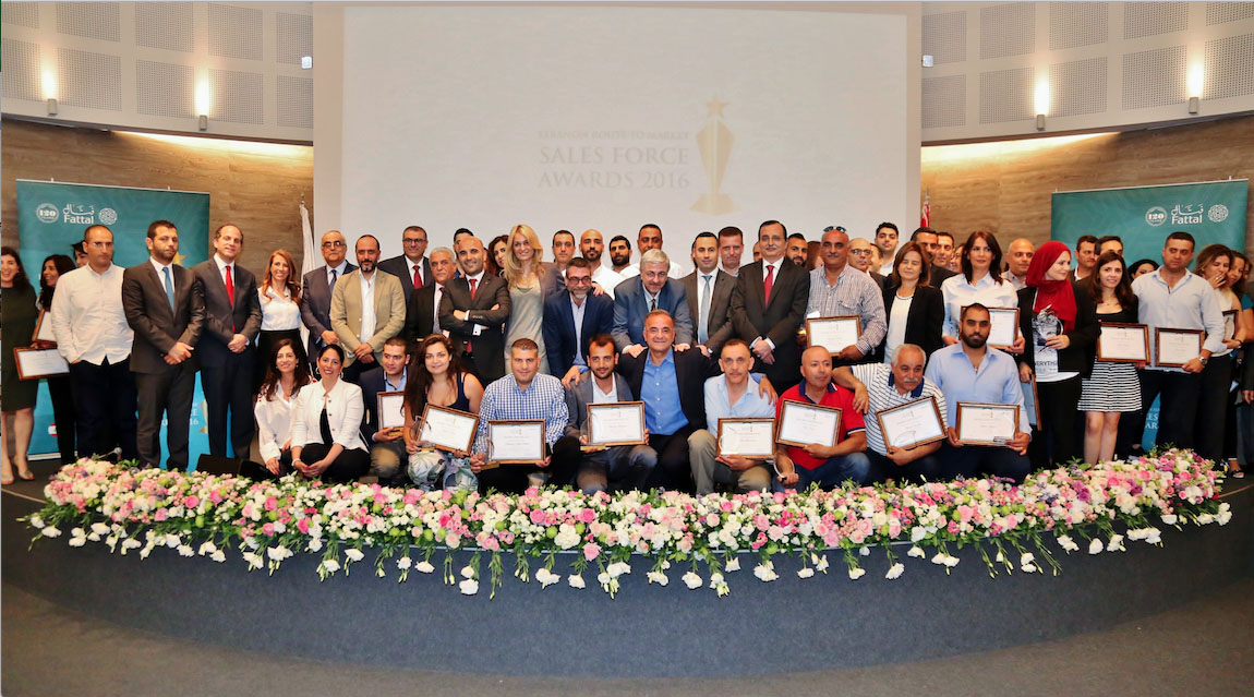 The-Lebanon-sales-team-posing-after-an-awards-ceremony-at-the-Bernard-Fattal-auditorium.-copy.jpg
